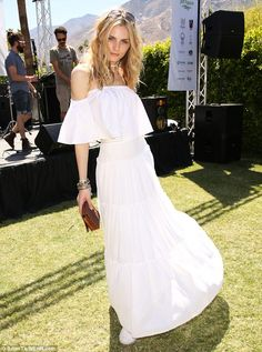 All eyes on her! Transgender model Andreja Pejic left heads turning on Monday as she slipped into an off-the-shoulder gown at the Coachella Paradise House Interview magazine party in Palm Springs, California