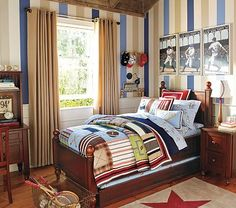Striped walls and oversized vintage sports posters with the madras (plaid) and the star rug. Diggin' it!