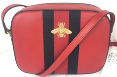 bba6d918c87a Get the trendiest Cross Body Bag of the season! The Gucci Leather Bee Web  Zip Top Red Cross Body Bag is a top 10 member favorite on Tradesy.