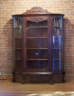 American Victorian carved oak curved glass china curio cabinet c1880
