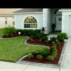 Landscaping idea - Edging and shrubs i like the different textures of the greenery by barbara.stone