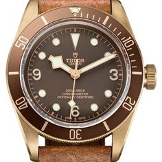 The latest incarnation of Tudor's signature Black Bay series comes in a 43 mm, aluminum bronze alloy case on an aged-leather strap. Descended from the 1954 Tudor Submariner, the Black Bay Bronze (a… Modern Watches, Fine Watches, Luxury Watches, Vintage Watches, Cool Watches, Rolex Watches, Watches For Men, Patek Philippe, Tudor Black Bay Bronze