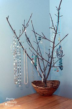 Beautiful way to display jewelry!  I want mine sitting in a tray of river rock pebbles for more bracelet storage.