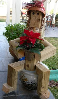 Scarecrow garden art! This is a wonderful way to use wood scraps/pieces!