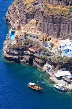 Dine at one of the restaurants of Amaudi Beach. The hike down the ledge of this bay town is the best way to take in the beauty of Santorini, Greece.