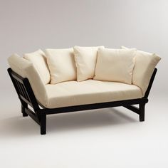 For style and versatility, nothing beats our compact Studio Day Sofa. It works as a chaise lounge or bed, easily transforming a living space into a sleeping space and vice versa. With the sides up it's a sofa. Fold one side down to form a chaise lounge. Put both sides down and it becomes a bed. Thick foam cushion and four pillows are a go-with-everything, off-white cotton.