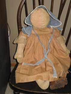 Early doll with hand made brown dress.....Large hands with sewn fingers.....  sweetanniesantiques.wix.com/sweetannies