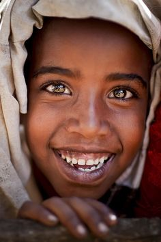 Some people smile with their whole soul.  And that makes my soul smile.  Sharing a smile – even through a photograph – can connect one soul to another.   Soul Smiles remind me that I am radically blessed