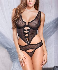 30a817415e4fd Floral jacquard mesh cut-out teddy with underwire cups, scallop lace trim,  rhinestone ring ladder detail, and strappy thong.