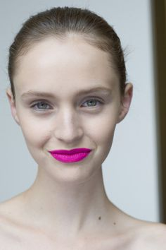 Looking for just the right amount of attention? Wear bright pink lips with barely a hint of additional makeup.