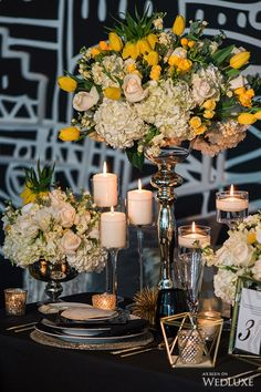 The vibrant yellow and white flower  arrangements against the bold, black and white backdrop complete the contemporary aesthetic inspired by the design styles of Art Deco. |  Photography by: Lisa Mark Photography | WedLuxe Magazine | #wedding #luxury #weddinginspiration #floral