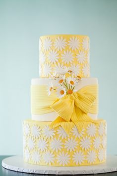 Wedding Cakes Happy, pretty daisy cake from Wild Orchid Baking Company, in beautiful (snowy) New Hampshire. - A cheerful yellow wedding cake covered in sugar daisies. Daisy Wedding Cakes, Daisy Cakes, Beautiful Wedding Cakes, Gorgeous Cakes, Pretty Cakes, Cute Cakes, Amazing Cakes, Cake Wedding, Ribbon Wedding