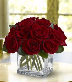 A dozen lush red roses, arranged into an unadorned bouquet, is an instant classic. Any Mother will fee loved and remembered with this arrangement. FlowerPetal.com
