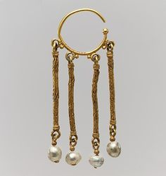 Earrings like these are found throughout the Byzantine world.  6th–7th century  Overall: 3 1/4 x 1 1/4 x 1/4 in. (8.3 x 3.2 x 0.7 cm) ring: 1 in. (2.5 cm) Met Museum