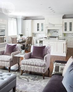 Gorgeous white, purple, and light grey open concept kitchen/living room