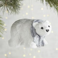 Pier 1 Imports Polar Bear Ornament (£6.53) ❤ liked on Polyvore featuring home, home decor, holiday decorations, white, white home decor, pier 1 imports, white ornaments and polar bear ornaments