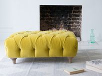 Dimple footstool in our Turmeric clever velvet