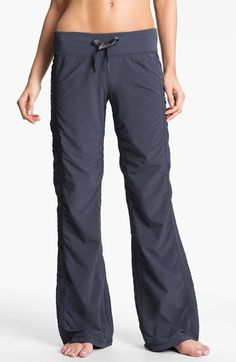 Free shipping and returns on Zella 'Move' Pants at Nordstrom.com. A satin drawstring cinches the wide, ribbed waist of woven, water-repellent pants seamed for a shapely yet forgiving fit. Internal drawcords at the hems adjust the ruching on the legs to add variety to the styling.