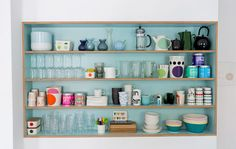 {built in shelving} in love with the blue background!