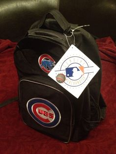 Chicago Cubs Backpack Black Color Embroidered Logo NEW TAGS in GinasOneStopShops Garage Sale in Glendale Heights , IL for $25.00.  Hey CUBS fans!!  GO CUBS GO!  This is the perfect accessory to bring to the game.....  Chicago Cubs Back Pack - NEW WITH TAGS  *100% Nylon *Embroidery and felt appliqué team logos on front *Front compartment includes organizer pocket *Mesh pocket on sides *Padded adjust ...