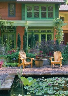 I love all of this ~ the house colors, the plantings, sitting area, pond <3
