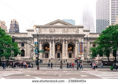 New York, USA - June 9, 2014: The classical facade of the New York Public Library on Fifth Avenue at 42nd Street.