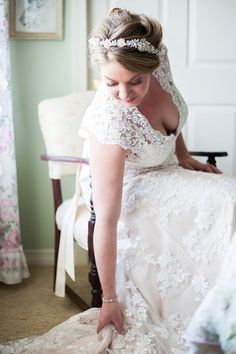 Floral headband, lace wedding dress by René Tate Photography