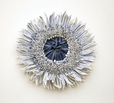 It's the vibrant cobalt color found in traditional Japanese pottery that inspires Israeli artist Zemer Peled to create her flower sculptures from blue hued ceramic shards. She builds sheets of clay, fires them, smashes them to thousands of pieces with a hammer and then builds them back together to construct these stunning, bursting blooms.