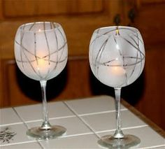 DIY wine glasses (or candle holders!) - Wrap rubber bands around the glass and cover with frosted glass spray paint. Cool idea of the day .. pass it on!