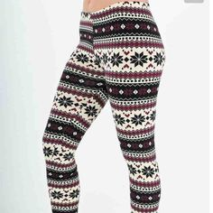 """Purple & black leggings!!! Fleece lined leggings! Adorable for any winter wardrobe! They were purchased as a """"one size fits most."""" There is a hole along the seam on one leg. Can easily be stitched by hand or with a machine, and unnoticed. Priced accordingly. Pants Leggings"""