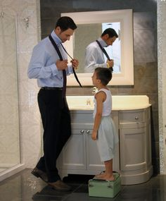 Very cute father/son picture... in a magnificient Ciot ceramic bathroom!
