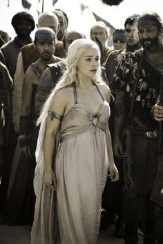 The wedding dress Daenerys wore during her nuptials to Drogo was a soft yet regal look. Even though she's was being married off to a Dothraki, the dragon clasp emphasized that Dany would always be a Targaryen at heart. (Courtesy of HBO)