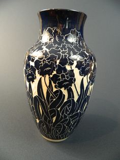 Daffodil Vase  Cobalt floral designs carved into white clay.