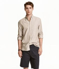Beige marl. Long-sleeved shirt in a soft linen and cotton weave with a button-down collar, a chest pocket and a yoke with a pleat and hanger at the back.