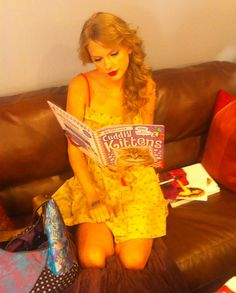 Taylor Swift reading about kittens and showing off some thigh. I think I'll be cropping this one . . .