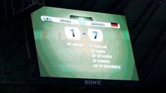 A big screen displays the final score line after the 2014 FIFA World Cup Brazil Semi Final match between Brazil and Germany