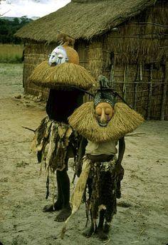 Suku masked ritual dancers; Dem. Rep. of Congo.