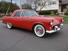 I like this tomato red 1955 Ford Thunderbird. It has a distinguished look.