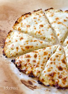 Cauliflower Pizza Crust Recipe -- Low carb, low calorie and gluten free cauliflower crust pizza that can take on any of your favourite toppings. Foolproof and delicious low carb meal recipe.