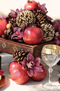 Winter Wedding Inspiration in Red and Gold : Centerpiece Details with Pomegranates and Pinecones / photo by Kismis Ink Photography / as seen on www.BrendasWeddingBlog.com