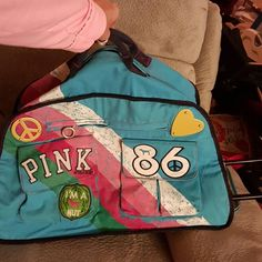Showing off what's new. What do you think? Victoria's Secret Pink luggage . How awesome is this zipper pouches inside cute pink dog lining that is Pinstripes in blue on the outside is a full pocket along one whole side that peace love two big pockets the other Rolling Wheels with an extendable handle this is the bomb Victoria's Secret Other