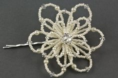 Felice pearl floral wedding hair grip The Felice hair grip is a stunning hair accessory design, it features a gorgeous beaded flower. The bloom comprises of three rows of beaded and shaped petals with a sparkly diamante centre. Each petal is made with tiny seed beads, pearls and crystals. Available as a hair grip or hair pin. Available in a fabulous range of seed bead, pearl and crystal colours