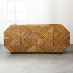 Shop Elston Rattan Credenza. Designed by Mermelada Estudio, rattan credenza shows 1960s Panama in attitude but modern in form. Four doors feature a repeating pattern with alternating diagonal lines of rattan core and open to a single shelf.