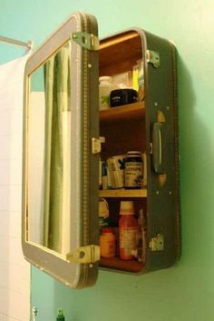 Upcycling an old suitcase into a medicine cabinet. Blake cut the front out of the suitcase and inserted a mirror and then created shelves and reinforced the inside with salvaged wood.