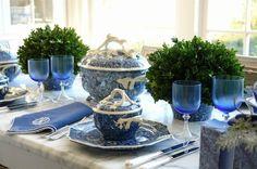 Blue-tinted glassware draws the eye toward these cute mini topiaries.  See more from Carolyne Roehm »   - Veranda.com
