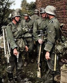 """Waffen SS soldiers with """"Germania"""" cuffs on their uniforms be. Ww2 Uniforms, German Uniforms, German Soldiers Ww2, German Army, Military Photos, Military History, Germany Ww2, War Photography, Germany"""