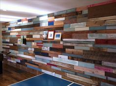 Wood wall installation using reclaimed wood from old pallets, wainscoting, wood taken from old barns, even old cedar trim taken out of our home after our remodel. There are no new pieces of wood in the wall, except one piece of wood flooring that was installed in the room. Reclaimed wood wall took about 1 1/2 days to install. 2x4's turned on edge installed for shelves.