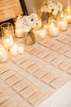 Table decorations for place card table Read More: http://www.stylemepretty.com/texas-weddings/austin/2013/12/11/traditional-austin-wedding/
