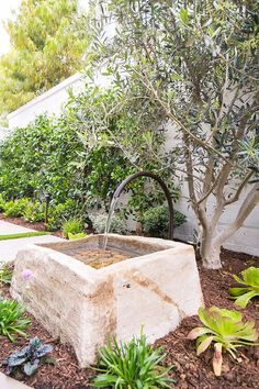 An oil rubbed bronze spout accents a concrete water fountain fitted in a backyard garden. Outdoor Water Features, Water Features In The Garden, Garden Features, Garden Fountains, Outdoor Fountains, Garden Ponds, Koi Ponds, Water Fountains, Mediterranean Garden