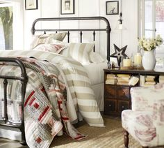 Bedroom inspiration--a classic, heavy iron bed overflowing with cozy linens in coordinating patterns. I don't like the colors of the bedding in the photo, but I love all the textures!